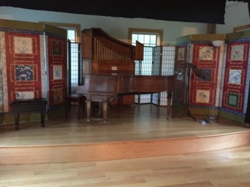 A stage and a Steinway